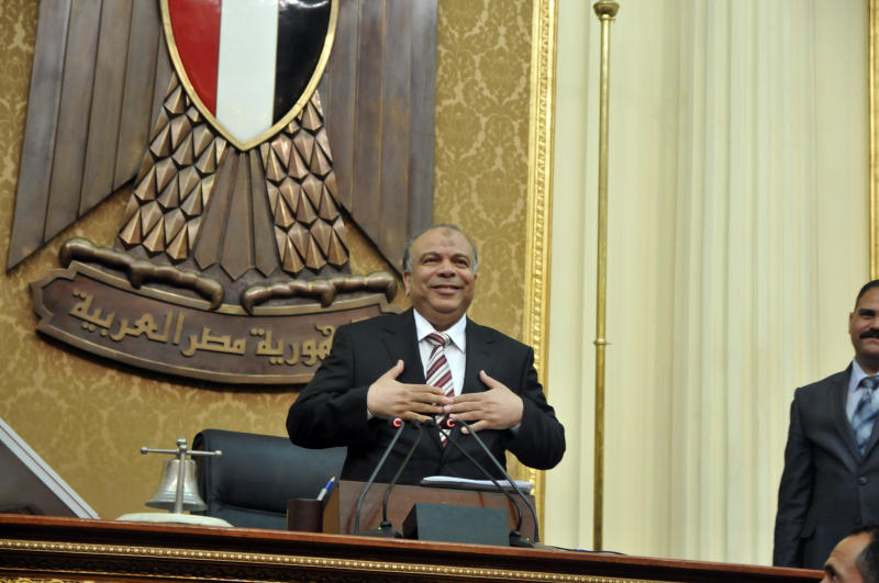 Egyptian Parliament Speaker Saad el-Katani reacts during a brief session of Parliament, the first since the country's high court ruled the chamber unconstitutional, in Cairo, Egypt, Tuesday, July 10, 2012. Egypt's Islamist-dominated parliament convened Tuesday in defiance of a ruling by the country's highest court and swiftly voted to seek a legal opinion on the decision that invalidated the chamber over apparent election irregularities. (AP Photo)