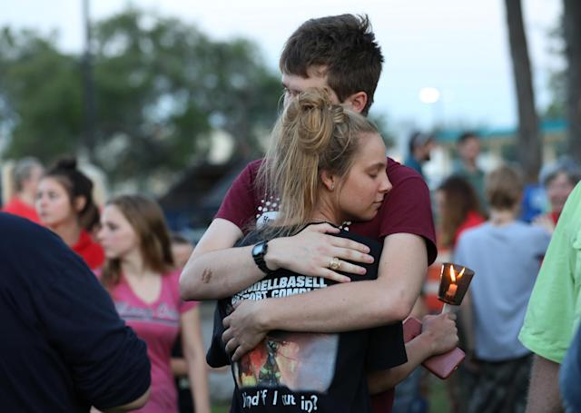 <p>Students embrace during a vigil held at the Texas First Bank after a shooting left several people dead at Santa Fe High School in Santa Fe, Texas, May 18, 2018. (Photo: Trish Badger/Reuters) </p>