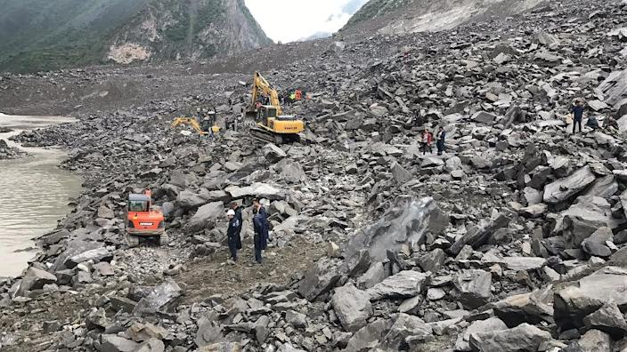 A couple and a baby were rescued and taken to hospital after 46 homes in the Chinese village of Xinmo were swallowed when the side of a mountain collapsed (AFP Photo/STR)