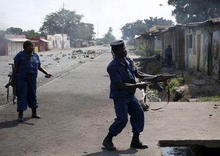 A policeman fires his AK-47 rifle during a protest against President Pierre Nkurunziza's decision to run for a third term in Bujumbura, Burundi, May 29, 2015. REUTERS/Goran Tomasevic