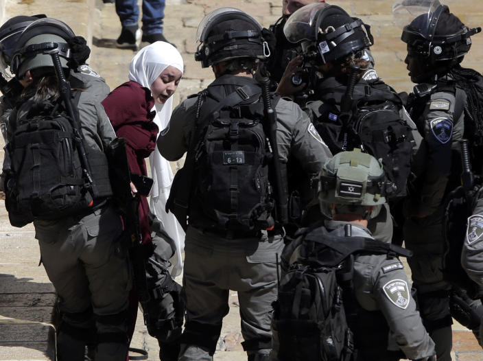 Israeli police arrests a Palestinian woman during clashes between Israeli security forces and Palestinian protesters in Jerusalem's Old City, Tuesday, May 18, 2021. (AP Photo/Mahmoud Illean)