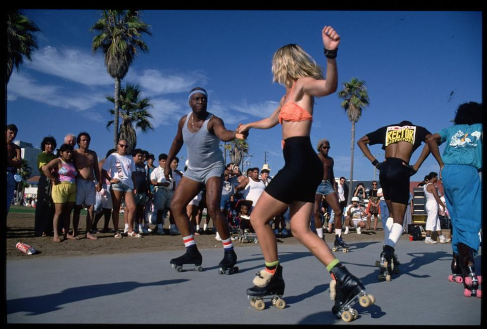 Roller skaters dance on the boardwalk at Venice Beach, Calif.