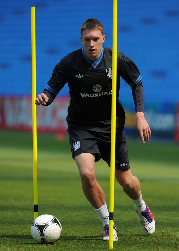 England's Phil Jones dribbles the ball during a training session at The Etihad stadium in Manchester, north-west England on May 24, 2012 ahead of their international friendly football match against Norway in Oslo on Saturday May 26. AFP PHOTO/ANDREW YATES. NOT FOR MARKETING OR ADVERTISING USE/RESTRICTED TO EDITORIAL USEANDREW YATES/AFP/GettyImages