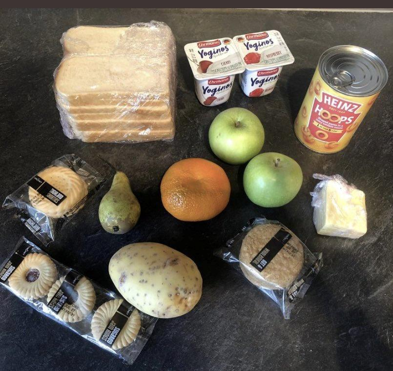 Parents on Twitter are sharing the paltry amount of food provided by the government as part of the appalling '£30' free school meals pack given to feed kids for two weeks -- worth a paltry £5.22 See SWNS story SWOCfood.