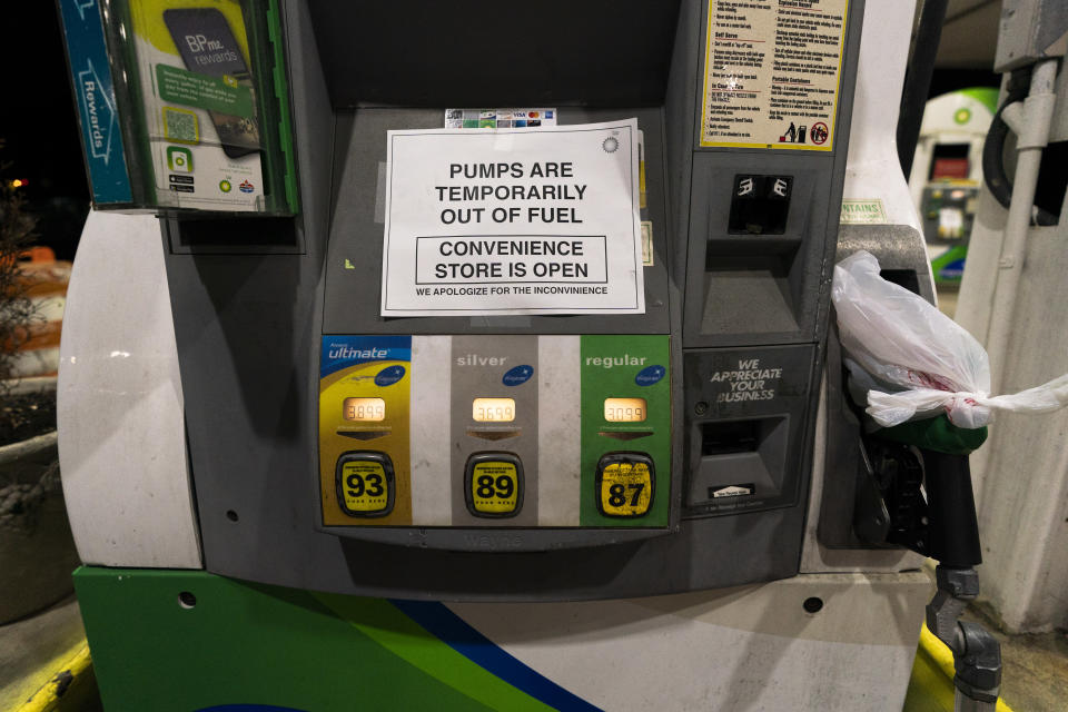 """A gas pump at a gas station in Silver Spring, Md., is out of service, notifying customers they are out of fuel, late Thursday, May 13, 2021. Motorists found gas pumps shrouded in plastic bags at tapped-out service stations across more than a dozen U.S. states Thursday while the operator of the nation's largest gasoline pipeline reported making """"substantial progress"""" in resolving the computer hack-induced shutdown responsible for the empty tanks. (AP Photo/Manuel Balce Ceneta)"""