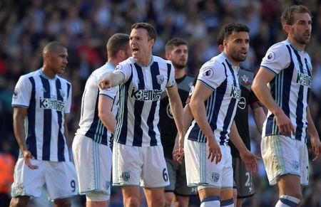 Britain Football Soccer - West Bromwich Albion v Southampton - Premier League - The Hawthorns - 8/4/17 West Bromwich Albion's Jonny Evans gestures as team mates look on Reuters / Anthony Devlin Livepic