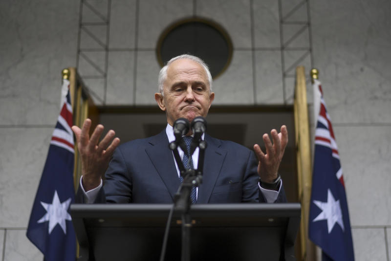 Australian Prime Minister Malcolm Turnbull speaks to the media during a press conference at Parliament House in Canberra. The beleaguered prime minister warned he will quit Parliament on Friday if his disgruntl