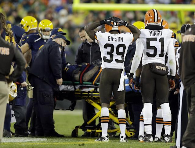 Cleveland Browns' Tashaun Gipson (39) watches as Green Bay Packers' Jermichael Finley is taken off the field on a stretcher after being injured after a catch during the second half of an NFL football game Sunday, Oct. 20, 2013, in Green Bay, Wis. (AP Photo/Tom Lynn)