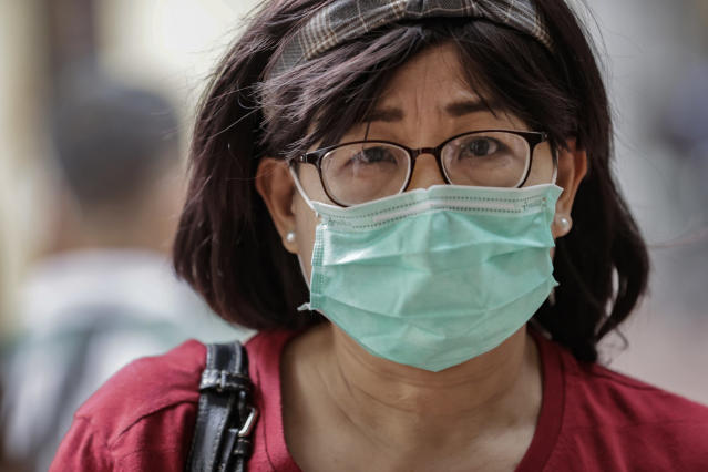 A woman wears a face mask in Manila, Philippines. (Ezra Acayan/Getty Images)