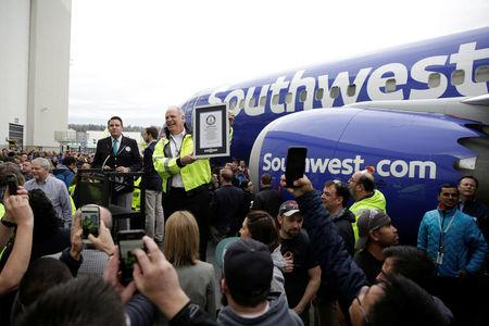 """Boeing 737 Program and Renton Site Vice President and General Manager Scott Campbell holds the Guinness World Record certificate for """"the most produced commercial jet aircraft model"""" as Boeing celebrates the 10,000th 737 to come off the production line in Renton, Washington, U.S., March 13, 2018.  REUTERS/Jason Redmond"""