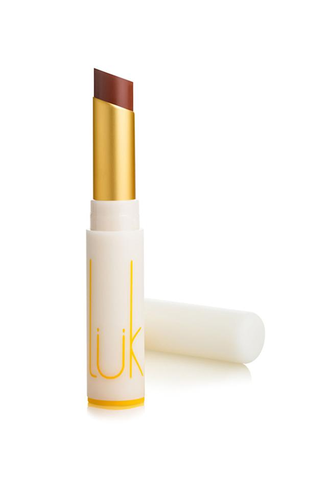 """<p><em>Nude Cinnamon Lip Nourish, $30</em></p><p><a rel=""""nofollow"""" href=""""https://lukbeautifood.com/product/nude-cinnamon-lip-nourish-natural-lipstick/"""">BUY IT</a><br></p><p>You wouldn't be the first who hasn't heard of the Aussi beauty brand Luk Beautifood. But, if you're looking for something sheer, don't mind a little fragrance (they're all scented with a rich blend of spice oils), and want a buttery-soft finish, these balms are it. They come in beautiful cloth packaging, too, so they make excellent gifts for literally anyone, but especially yourself.  </p>"""