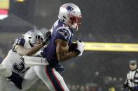 New England Patriots wide receiver N'Keal Harry, right, catches a touchdown pass in the end zone as Dallas Cowboys cornerback Byron Jones tries to defend in the first half of an NFL football game, Sunday, Nov. 24, 2019, in Foxborough, Mass. (AP Photo/Elise Amendola)