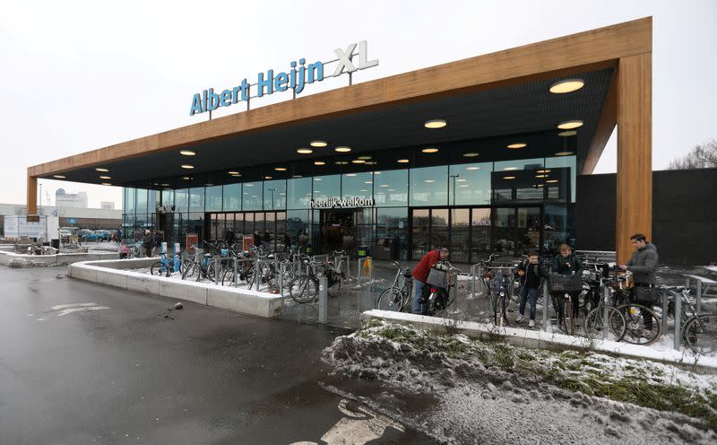 FILE PHOTO: A logo of Albert Heijn is seen at the entrance of the shop operated by Ahold Delhaize, the Dutch-Belgian supermarket operator