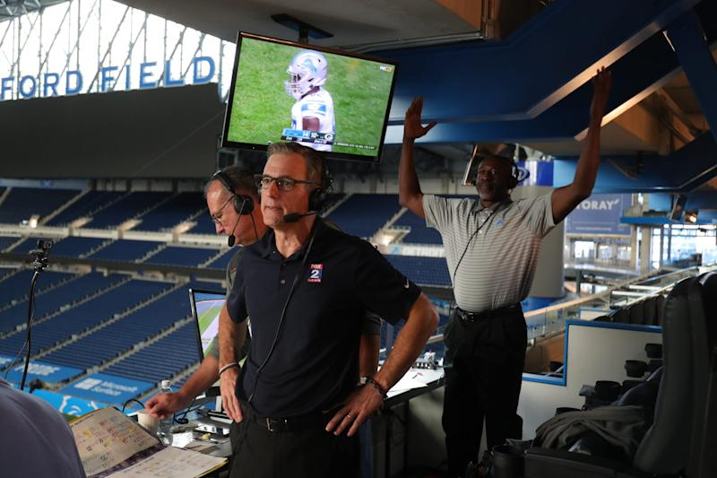 The WJR-AM broadcast team of Dan Miller (foreground), spotter Joe Abramson and Lomas Brown (background) on Sunday, September 20, 2020 call the action of the Detroit Lions game against the Green Bay Packers. The broadcast was done at Ford Field though the team was playing at Lambeau Field.