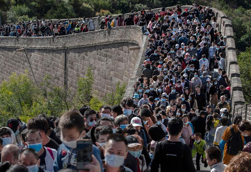 Chinese tourists crowd in a bottleneck as they move slowly on a section of the Great Wall at Badaling.