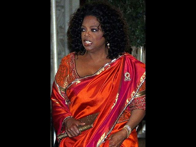 <b>2. Oprah Winfrey<br><br></b>She is one of the most influential people in the world. Oprah draped an  orange and gold sari as she attended the high-profile party hosted by  socialite Parmeshwar Godrej in Mumbai. Winfrey came in the party with  the Bachchan family.
