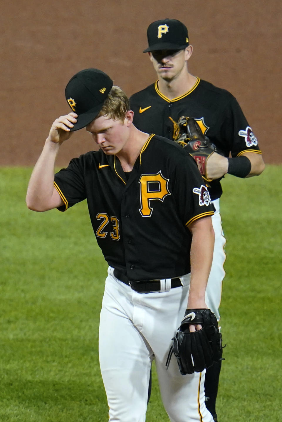 Pittsburgh Pirates starting pitcher Mitch Keller (23) waits to hand the ball to manager Derek Shelton and leave the game, during the fifth inning of a baseball game against the Chicago Cubs in Pittsburgh, Tuesday, Sept. 28, 2021. (AP Photo/Gene J. Puskar)