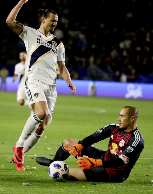 New York Red Bulls goalkeeper Luis Robles blocks a shot by LA Galaxy forward Zlatan Ibrahimovic during the second half of an MLS soccer match Saturday, April 28, 2018 in Carson, Calif. The Red Bulls won 3-2. (AP Photo/Chris Carlson)