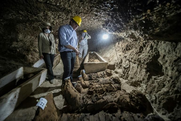 Egyptian Antiquities Minister Khaled el-Enany (C) speaks to media on May 13, 2017, in front of mummies discovered in catacombs in Touna el-Gabal district, Minya province, in central Egypt