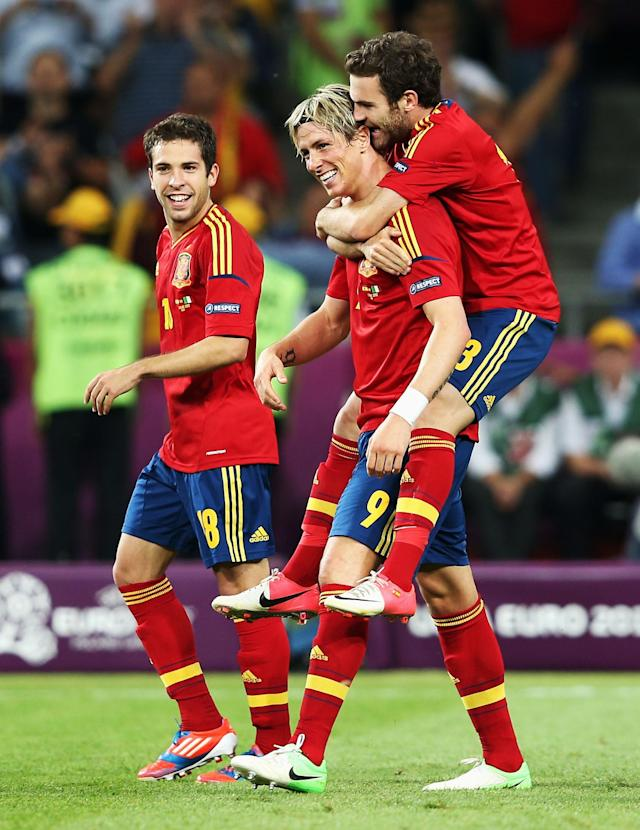 KIEV, UKRAINE - JULY 01: Jordi Alba and Fernando Torres of Spain celebrate with team-mate Juan Mata after he scored their fourth goal during the UEFA EURO 2012 final match between Spain and Italy at the Olympic Stadium on July 1, 2012 in Kiev, Ukraine. (Photo by Alex Grimm/Getty Images)