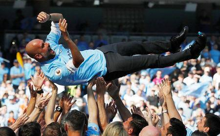 Soccer Football - Premier League - Manchester City vs Huddersfield Town - Etihad Stadium, Manchester, Britain - May 6, 2018 Manchester City manager Pep Guardiola and their players and staff celebrate winning the premier league title Action Images via Reuters/Carl Recine