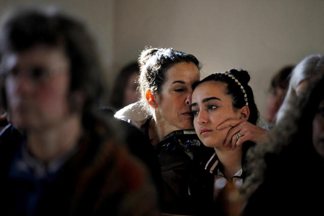<p>Elizabeth Bogdanoff, left, kisses her daughter Julia, 13, both of Newtown, Conn., during a prayer service at St John's Episcopal Church in Newtown, Dec. 15, 2012. The massacre of 26 children and adults at Sandy Hook Elementary school elicited horror and soul-searching around the world even as it raised more basic questions about why the gunman, 20-year-old Adam Lanza, would have been driven to such a crime and how he chose his victims. (AP Photo/David Goldman) </p>