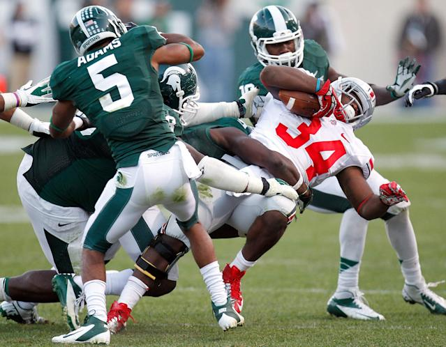 EAST LANSING, MI - SEPTEMBER 29: Carlos Hyde #34 of the Ohio State Buckeyes battles for yards during a fourth quarter run while playing the Michigan State Spartans at Spartan Stadium on September 29, 2012 in East Lansing, Michigan. Ohio State won the game 17-16. (Photo by Gregory Shamus/Getty Images)