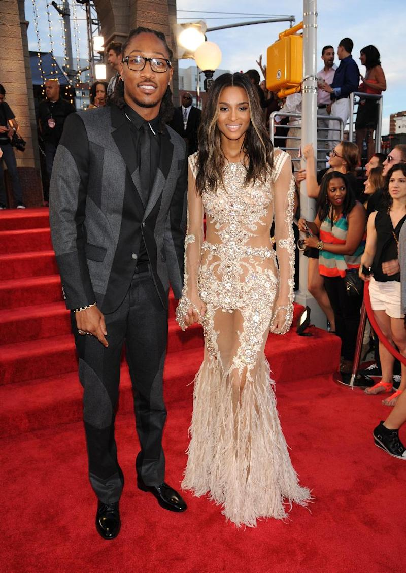 File-This Aug. 25, 2013 file photo shows The Future, left, and Ciara arriving at the MTV Video Music Awards at the Barclays Center in the Brooklyn borough of New York. Ciara's future is Future: The R&B singer and the rapper-producer are engaged. Future surprised the Grammy-winner with a 15-carat diamond ring over the weekend, their publicist, Chris Chambers, told The Associated Press on Sunday Oct. 27, 2013. She was already celebrating her 28th birthday in New York when he proposed. (Photo by Scott Gries/Invision/AP, File)