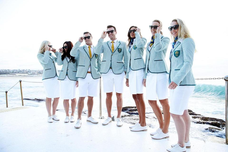 <p>The Australians' single-breasted blazers and white bottoms are jauntily accessorized with gold scarves for the ladies and striped green-and-gold ties for the men. Everyone gets Toms shoes.<i> (Photo: Getty Images)</i></p>