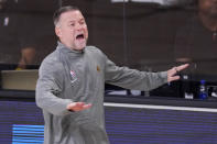 Denver Nuggets head coach Michael Malone yells to his players during the second half of an NBA conference final playoff basketball game against the Los Angeles Lakers Thursday, Sept. 24, 2020, in Lake Buena Vista, Fla. (AP Photo/Mark J. Terrill)