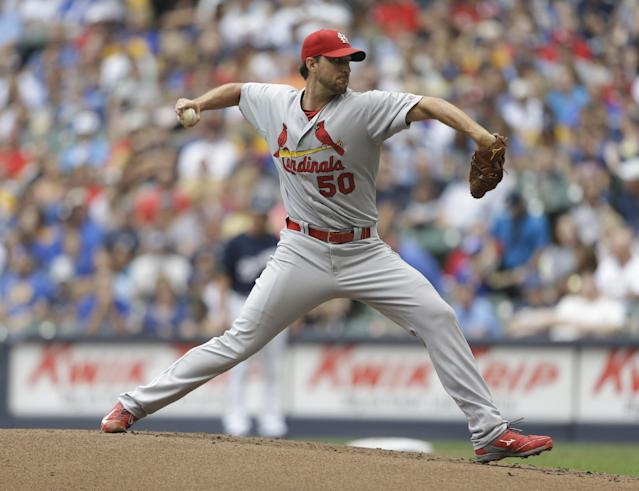 St. Louis Cardinals starting pitcher Adam Wainwright throws to the Milwaukee Brewers during the first inning of a baseball game Saturday, July 12, 2014, in Milwaukee. (AP Photo/Jeffrey Phelps)