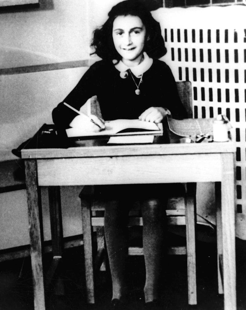 FILE - This is an undated file photo of Anne Frank, the young Jewish girl who, with her family, hid from the Nazis in Amsterdam, Netherlands, during World War II.  The Mormon church is apologizing again just a week after it was learned that the parents of Holocaust survivor and Jewish rights advocate Simon Wiesenthal were posthumously baptized by the organization in a controversial ritual that Mormons believe allows deceased people a way to the afterlife but offends members of many other religions. This time, the apology is aimed at family members of other Holocaust survivors who have also been baptized posthumously, and notable sympathizers, such as Anne Frank. Mormon researcher Helen Radkey, who revealed the Wiesenthal baptisms, said this week she found Frank's name in proxy baptism records dated Feb. 18, showing the ritual was performed in the Santo Domingo Temple in the Dominican Republic.  (AP Photo, File)