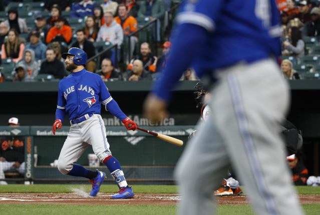 Toronto Blue Jays' Kevin Pillar singles in the first inning of a baseball game against the Baltimore Orioles, Wednesday, April 11, 2018, in Baltimore. Justin Smoak scored on the play. (AP Photo/Patrick Semansky)