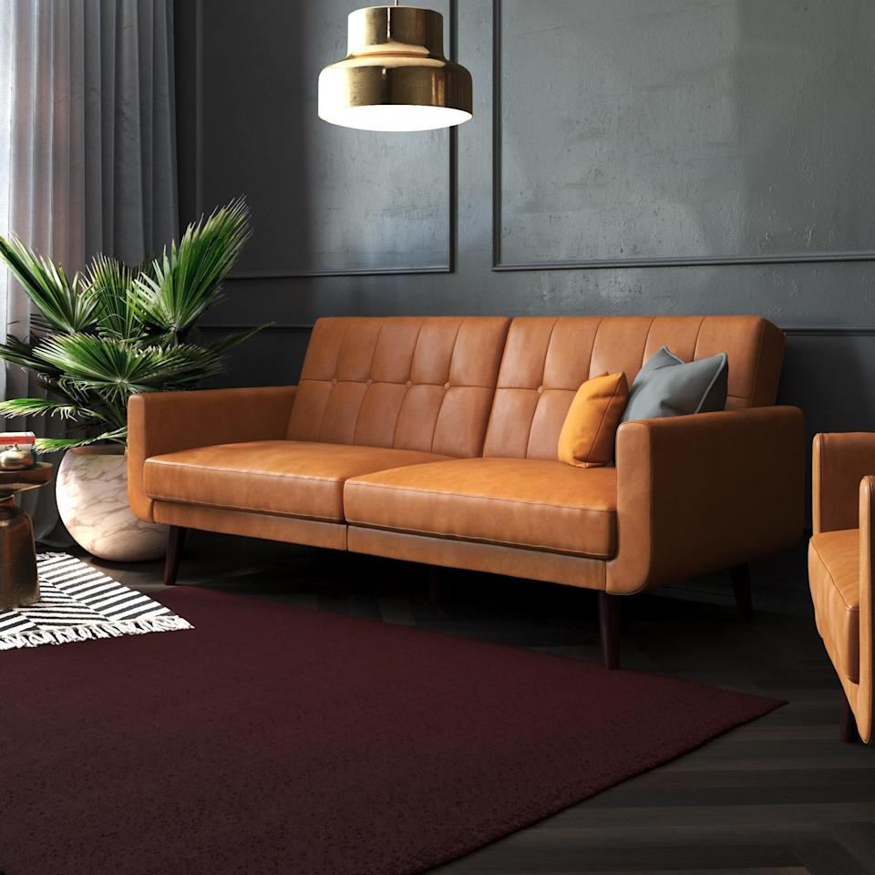 <p>This <span>Better Homes &amp; Gardens Nola Modern Futon</span> ($319) is a stylish and functional piece that will add texture to your living room.</p>