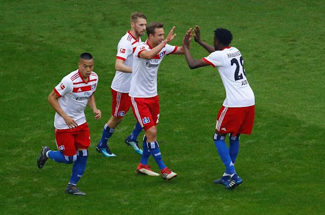 Soccer Football - Bundesliga - Hamburger SV v Borussia Moenchengladbach - Volksparkstadion, Hamburg, Germany - May 12, 2018 Hamburg's Aaron Hunt celebrates scoring their first goal with Matti Steinmann, Gideon Jung and Bobby Wood REUTERS/Morris Mac Matzen DFL RULES TO LIMIT THE ONLINE USAGE DURING MATCH TIME TO 15 PICTURES PER GAME. IMAGE SEQUENCES TO SIMULATE VIDEO IS NOT ALLOWED AT ANY TIME. FOR FURTHER QUERIES PLEASE CONTACT DFL DIRECTLY AT + 49 69 650050