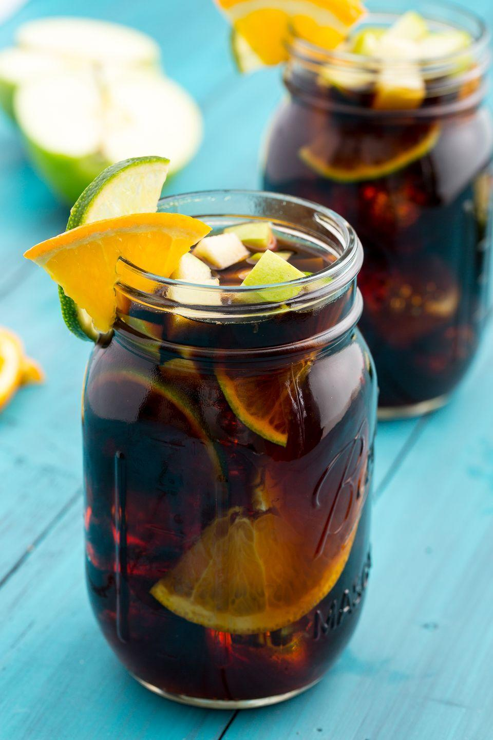 """<p>Drink this coffee black—the fruit, Cointreau and simple syrup sweeten things up, so you don't even miss milk or cream.</p><p>Get the recipe from <a href=""""https://www.delish.com/cooking/recipes/a47528/cold-brew-sangria-recipe/"""" rel=""""nofollow noopener"""" target=""""_blank"""" data-ylk=""""slk:Delish"""" class=""""link rapid-noclick-resp"""">Delish</a>.</p>"""