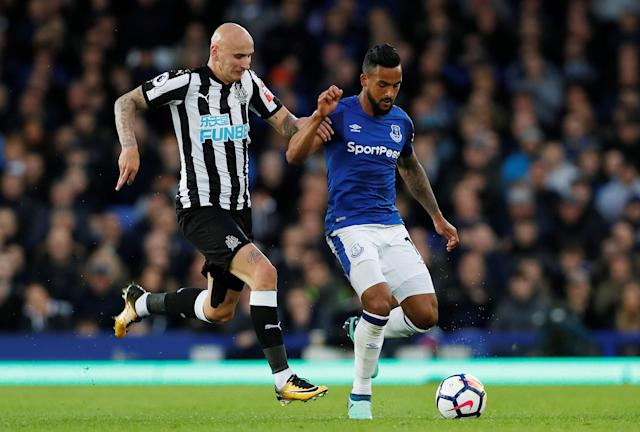"Soccer Football - Premier League - Everton v Newcastle United - Goodison Park, Liverpool, Britain - April 23, 2018 Newcastle United's Jonjo Shelvey in action with Everton's Theo Walcott Action Images via Reuters/Lee Smith EDITORIAL USE ONLY. No use with unauthorized audio, video, data, fixture lists, club/league logos or ""live"" services. Online in-match use limited to 75 images, no video emulation. No use in betting, games or single club/league/player publications. Please contact your account representative for further details."