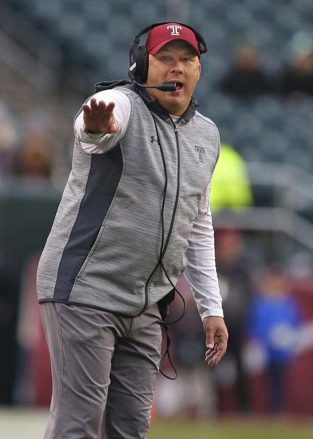 FILE - In this Nov. 18, 2017, file photo, Temple head coach Geoff Collins gestures to his team during the third quarter of an NCAA college football game against Central Florida, in Philadelphia. Georgia Tech has hired Temple coach Geoff Collins to replace Paul Johnson as the Yellow Jackets coach. Collins, a Conyers, Georgia native, is a former Florida and Mississippi State defensive coordinator who was 15-10 in two seasons at Temple. Georgia Tech announced the hire on Friday, Dec. 7, 2018, and planned a news conference for later in the day. (AP Photo/Rich Schultz, File)