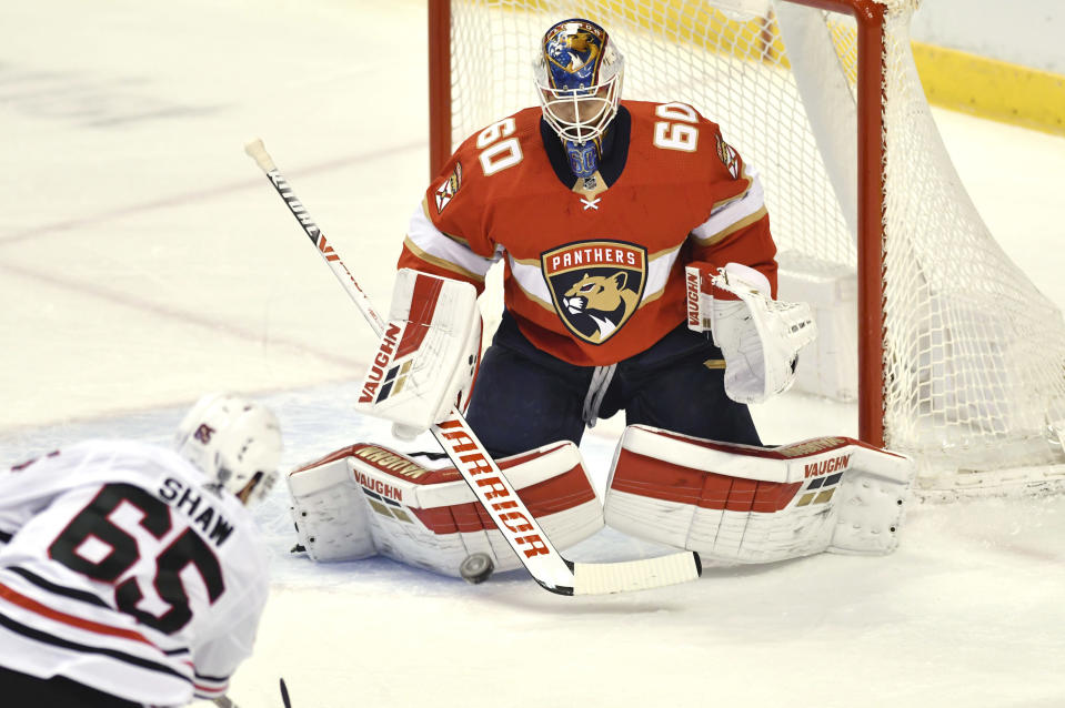 Florida Panthers goaltender Chris Driedger (60) makes a save on a shot by Chicago Blackhawks right wing Andrew Shaw (65) during the first period of an NHL hockey game Sunday, Jan. 17, 2021, in Sunrise, Fla. (AP Photo/Jim Rassol)