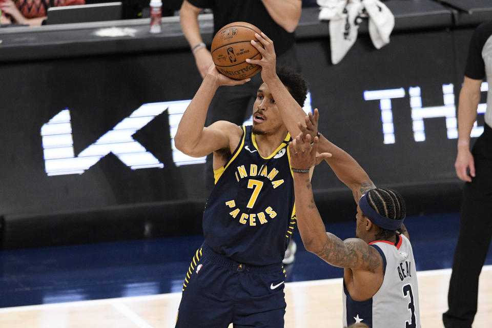 Indiana Pacers guard Malcolm Brogdon (7) shoots against Washington Wizards guard Bradley Beal (3) during the second half of an NBA basketball Eastern Conference play-in game, Thursday, May 20, 2021, in Washington. (AP Photo/Nick Wass)