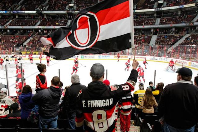 "An Ottawa Senators fan waves a team flag before a game against the Boston Bruins on March 10. <span class=""copyright"">(Jana Chytilova / Getty Images)</span>"