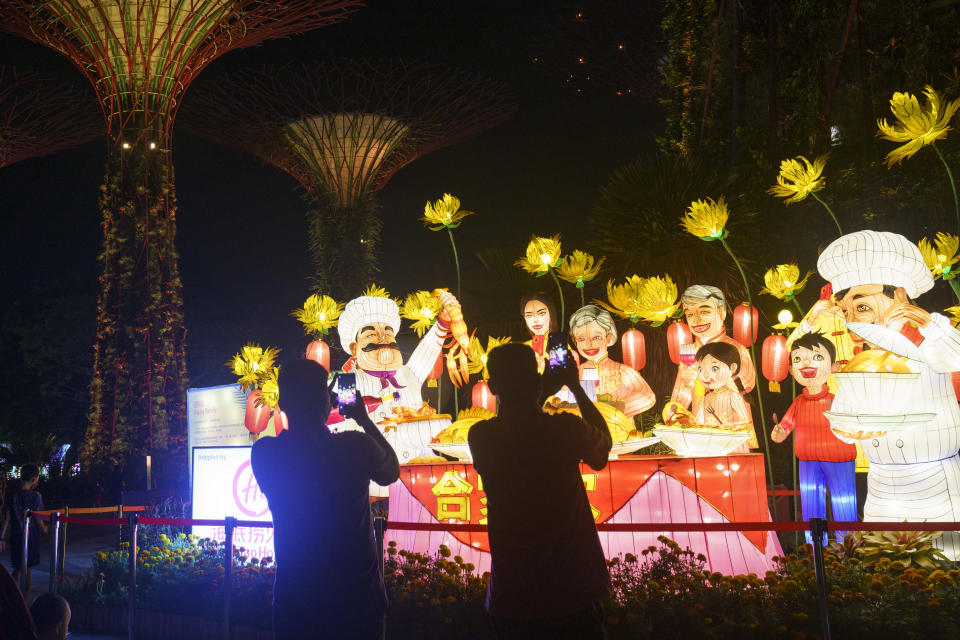 People taking photos at the River Hongbao event at the Gardens by the Bay in Singapore.