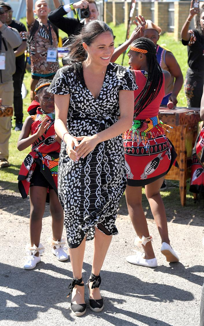 Meghan visits the Nyanga Township in Cape Town with Harry during their royal tour of South Africa.