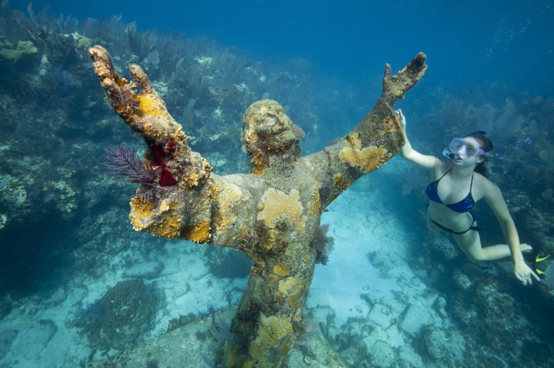 The Statue of Christ of the Abyss reaches out to the underwater world.
