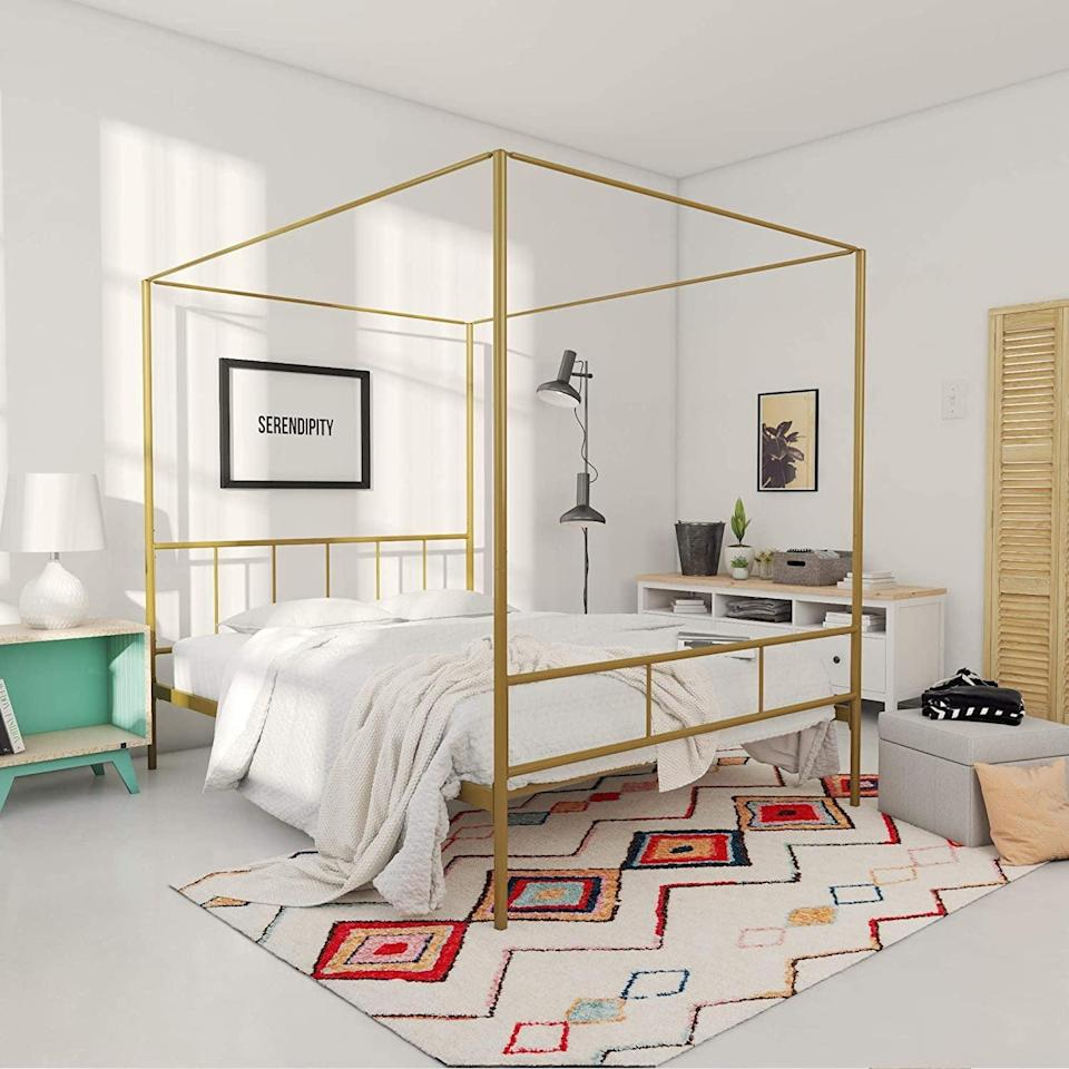 <p>Add a touch of royalty to your bedroom with this elevated <span>Novogratz Marion Canopy Bed Frame</span> ($185, originally $266). It will help anchor the room by adding a sense of protection.</p>
