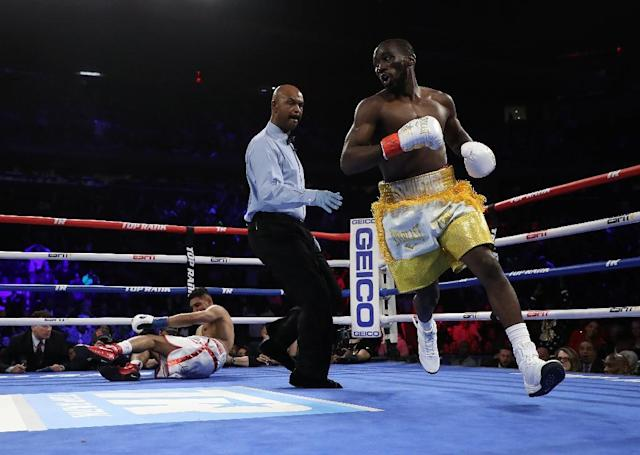 Terence Crawford knocks down Amir Khan in the first round during their WBO welterweight title fight at Madison Square Garden (AFP Photo/AL BELLO)