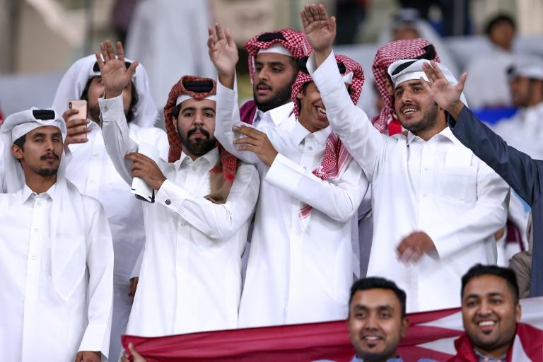 """Qatari football fans cheer as the emirate hosts Saudi Arabia in the semi-final of the Gulf Cup, in what was seen as """"sports diplomacy"""" (AFP Photo/MUSTAFA ABUMUNES)"""