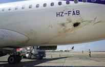 A handout image from Saudi authorities showed what they said was damage to a Flyadeal Airbus A320-214 at Abha airport after Wednesday's attack