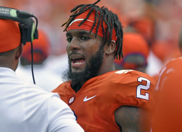 FILE - In this Sept. 1, 2018, file photo, Clemson quarterback Kelly Bryant talks to a Clemson coach on the sidelines during the first half of an NCAA college football game against Furman, in Clemson, S.C. The former Clemson standout was benched in favor of freshman quarterback Trevor Lawrence following the Tigers Week 4 win over Georgia Tech, and immediately became of the most sought-after transfers in the country. On Dec. 4, 2018, Bryant announced in a video he was transferring to Missouri. (AP Photo/Richard Shiro, File)