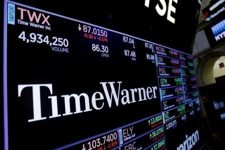 A screen shows the current price of Time Warner shares, above the floor of the New York Stock Exchange, shortly after the opening bell in New York, U.S., November 15, 2017. REUTERS/Lucas Jackson